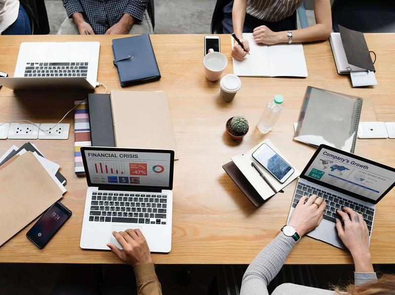 adults analyzing a business